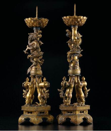 A LARGE AND FINE PAIR OF GILT-BRONZE 'DRAGON' CANDLESTICKS