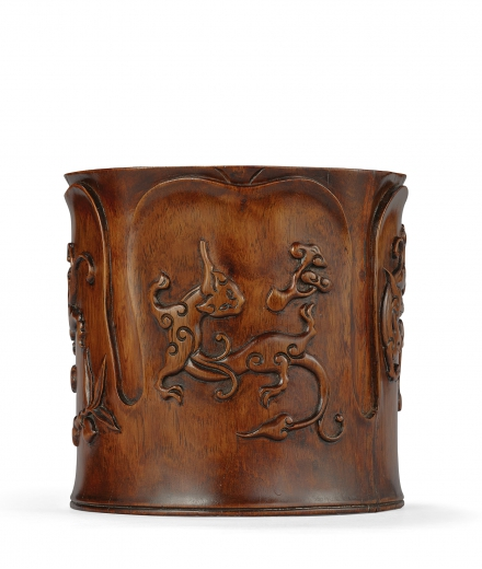 A CARVED HUANGHUALI 'DRAGON' BRUSHPOT