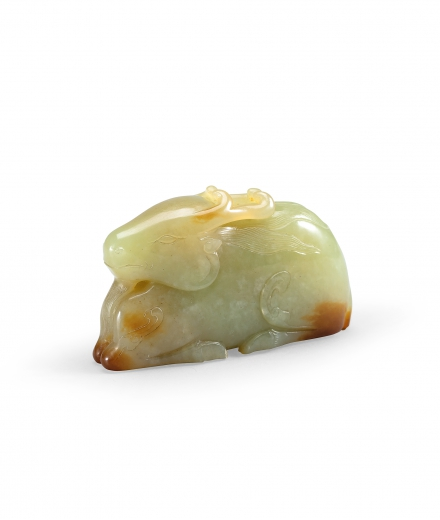 A CELADON AND YELLOW JADE RECUMBENT DEER
